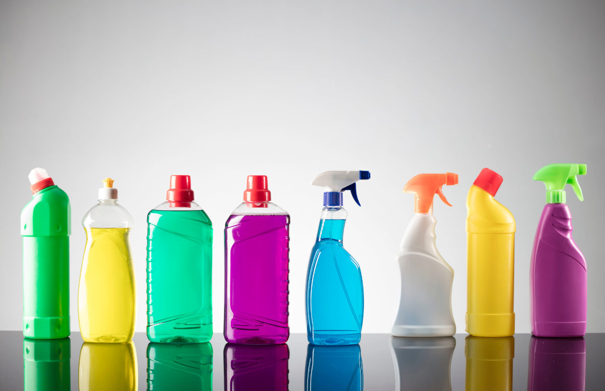 Various bottles of cleaner in different colours.