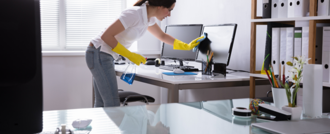 Woman cleaning an office.