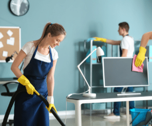 team of cleaning specialists cleaning an office