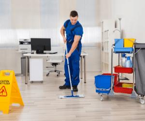 man mopping office floors