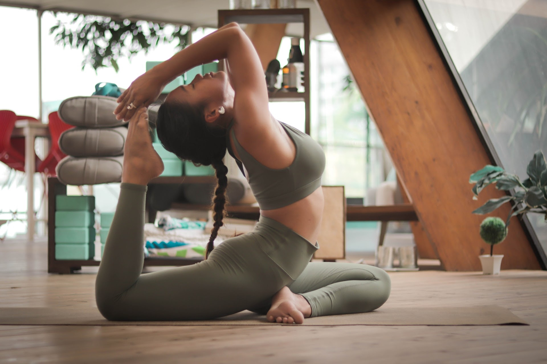 A woman doing yoga in a studio