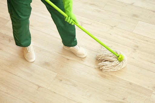 Janitor mopping a wood floor.